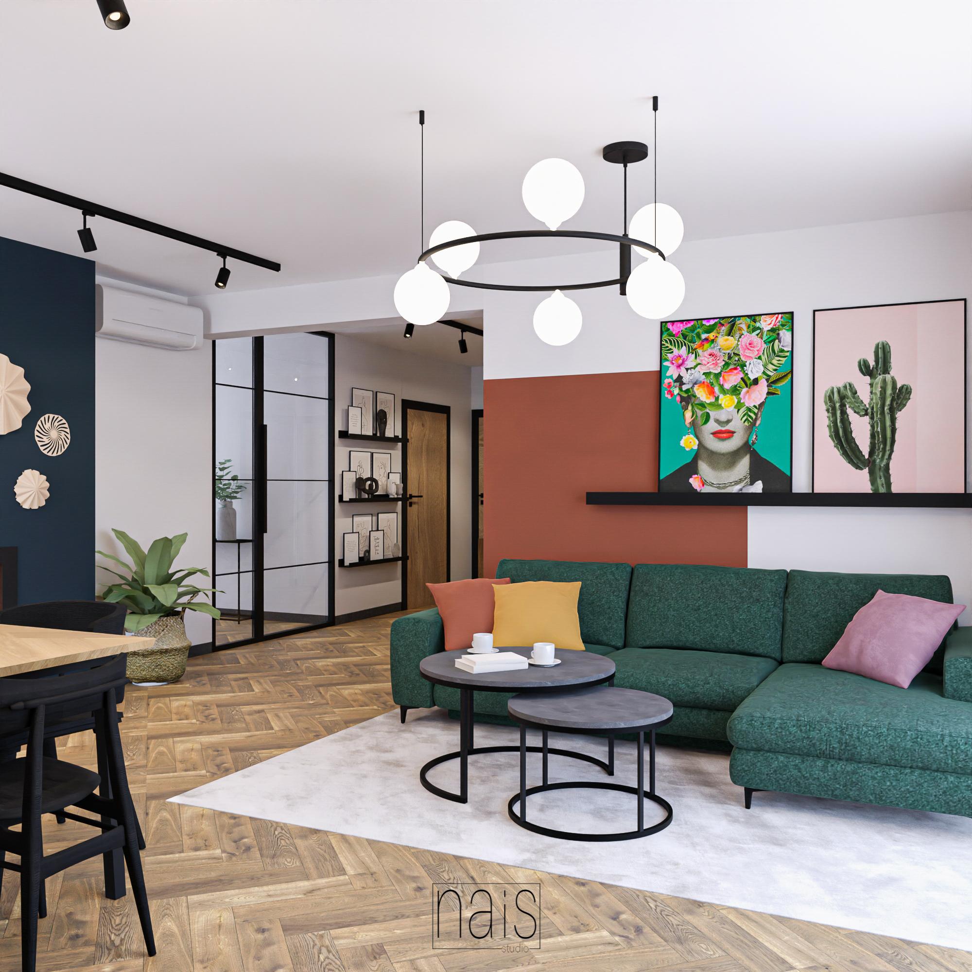 kolorowy-salon-zielony-naroznik-sciana-pomalowana-grafiki-nad-sofa-przeszklone